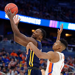 Univeristy of Florida Gators forward Devin Robinson fights for a rebound against East Tennessee State University Buccaneers forward Tevin Glass during the frist half as the Gators advance to the second round of 2017 NCAA Tournament with a win over the  East Tennessee State Buccaneers 80-65.  March 16th, 2017.  Gator Country photo by David Bowie.