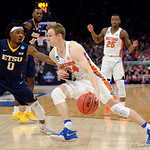 Univeristy of Florida Gators guard Canyon Barry drives toward the basket during the first half as the Gators advance to the second round of 2017 NCAA Tournament with a win over the  East Tennessee State Buccaneers 80-65.  March 16th, 2017.  Gator Country photo by David Bowie.