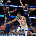 Univeristy of Florida Gators guard KeVaughn Allen dishes the ball off leading to a basket during the second half as the Gators advance to the second round of 2017 NCAA Tournament with a win over the  East Tennessee State Buccaneers 80-65.  March 16th, 2017.  Gator Country photo by David Bowie.