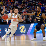 Univeristy of Florida Gators guard Chris Chiozza drves to the basket past East Tennessee State University Buccaneers guard Desonta Bradford during the second half as the Gators advance to the second round of 2017 NCAA Tournament with a win over the  East Tennessee State Buccaneers 80-65.  March 16th, 2017.  Gator Country photo by David Bowie.