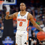 Univeristy of Florida Gators guard Kasey Hill dribbles up courtduring the second half as the Gators advance to the second round of 2017 NCAA Tournament with a win over the  East Tennessee State Buccaneers 80-65.  March 16th, 2017.  Gator Country photo by David Bowie.