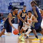 Univeristy of Florida Gators guard Kasey Hill defending East Tennessee State University Buccaneers guard T.J. Cromer during the second half as the Gators advance to the second round of 2017 NCAA Tournament with a win over the  East Tennessee State Buccaneers 80-65.  March 16th, 2017.  Gator Country photo by David Bowie.