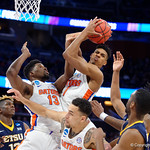 Univeristy of Florida Gators forward Devin Robinson grabs a rebound during the frist half as the Gators advance to the second round of 2017 NCAA Tournament with a win over the  East Tennessee State Buccaneers 80-65.  March 16th, 2017.  Gator Country photo by David Bowie.
