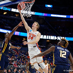 Univeristy of Florida Gators guard Canyon Barry drives to the basket during the second half as the Gators advance to the second round of 2017 NCAA Tournament with a win over the  East Tennessee State Buccaneers 80-65.  March 16th, 2017.  Gator Country photo by David Bowie.