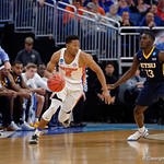 Univeristy of Florida Gators guard KeVaughn Allen dribbling in the offensive end during the first half as the Gators advance to the second round of 2017 NCAA Tournament with a win over the  East Tennessee State Buccaneers 80-65.  March 16th, 2017.  Gator Country photo by David Bowie.