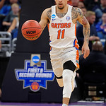 Univeristy of Florida Gators guard Chris Chiozza dribbles uo court during the first half as the Gators advance to the second round of 2017 NCAA Tournament with a win over the  East Tennessee State Buccaneers 80-65.  March 16th, 2017.  Gator Country photo by David Bowie.