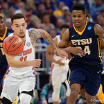 Univeristy of Florida Gators guard Chris Chiozza and East Tennessee State University Buccaneers guard Jermaine Long race for a loose ball during the second half as the Gators advance to the second round of 2017 NCAA Tournament with a win over the  East Tennessee State Buccaneers 80-65.  March 16th, 2017.  Gator Country photo by David Bowie.