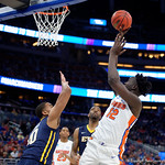 Univeristy of Florida Gators center Gorjok Gak shooting during the first half as the Gators advance to the second round of 2017 NCAA Tournament with a win over the  East Tennessee State Buccaneers 80-65.  March 16th, 2017.  Gator Country photo by David Bowie.