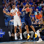 Univeristy of Florida Gators forward Justin Leon leaping for a rebound against East Tennessee State University Buccaneers forward Isaac Banks during the second half as the Gators advance to the second round of 2017 NCAA Tournament with a win over the  East Tennessee State Buccaneers 80-65.  March 16th, 2017.  Gator Country photo by David Bowie.