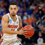 Univeristy of Florida Gators guard Chris Chiozza dribbles up court second half as the Gators advance to the second round of 2017 NCAA Tournament with a win over the  East Tennessee State Buccaneers 80-65.  March 16th, 2017.  Gator Country photo by David Bowie.