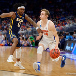 Univeristy of Florida Gators guard Canyon Barry dribbling in the offensive end during the first half as the Gators advance to the second round of 2017 NCAA Tournament with a win over the  East Tennessee State Buccaneers 80-65.  March 16th, 2017.  Gator Country photo by David Bowie.