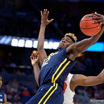 East Tennessee State University Buccaneers forward Hanner Mosquera-Perea leaping for a rebound during the second half as the Gators advance to the second round of 2017 NCAA Tournament with a win over the  East Tennessee State Buccaneers 80-65.  March 16th, 2017.  Gator Country photo by David Bowie.