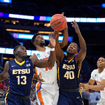 Univeristy of Florida Gators forward Kevarrius Hayes fighting for a rebound against East Tennessee State University Buccaneers forward Tevin Glass and East Tennessee State University Buccaneers guard A.J. Merriweather during he first half as the Gators advance to the second round of 2017 NCAA Tournament with a win over the  East Tennessee State Buccaneers 80-65.  March 16th, 2017.  Gator Country photo by David Bowie.