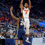 Univeristy of Florida Gators guard KeVaughn Allen shooting from deep during the second half as the Gators advance to the second round of 2017 NCAA Tournament with a win over the  East Tennessee State Buccaneers 80-65.  March 16th, 2017.  Gator Country photo by David Bowie.