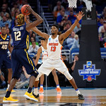 Univeristy of Florida Gators forward Kevarrius Hayes defedning East Tennessee State University Buccaneers forward Hanner Mosquera-Perea during the first half as the Gators advance to the second round of 2017 NCAA Tournament with a win over the  East Tennessee State Buccaneers 80-65.  March 16th, 2017.  Gator Country photo by David Bowie.