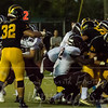 Johnny Buchanan (21) fighting forward for a SJV touchdown in the first half