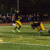 Johnny Buchanan (21) falling forward on a run in the second quarter