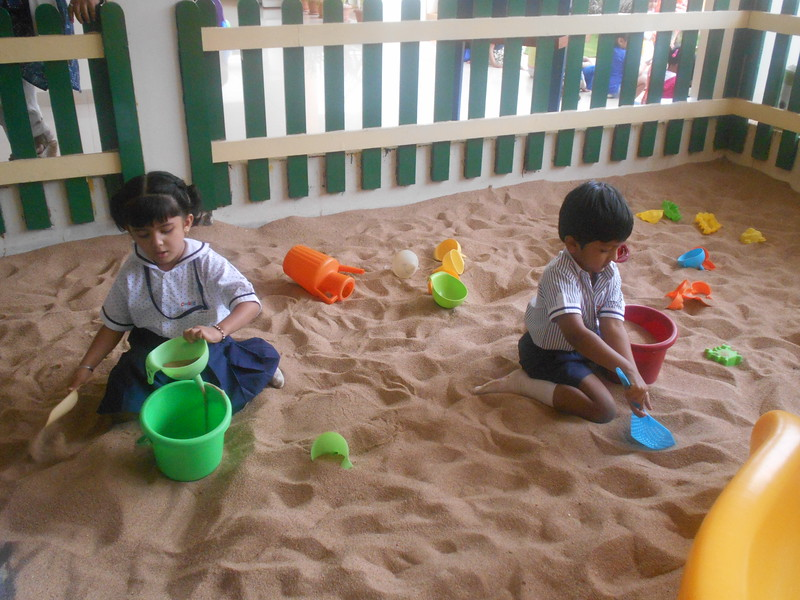 ENGAGED IN SAND PLAY