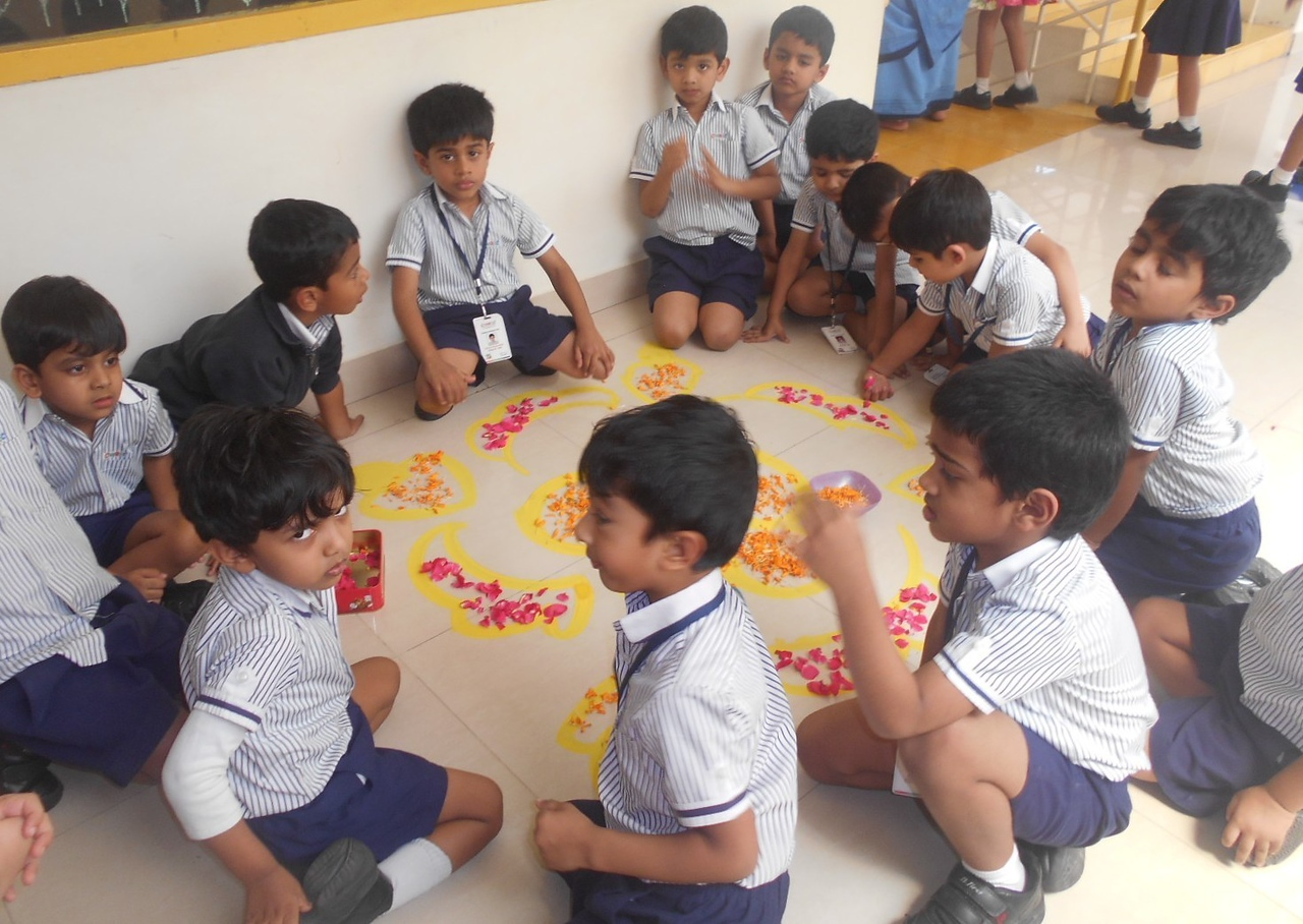 RANGOLI WITH DIFFERENT FLOWERS