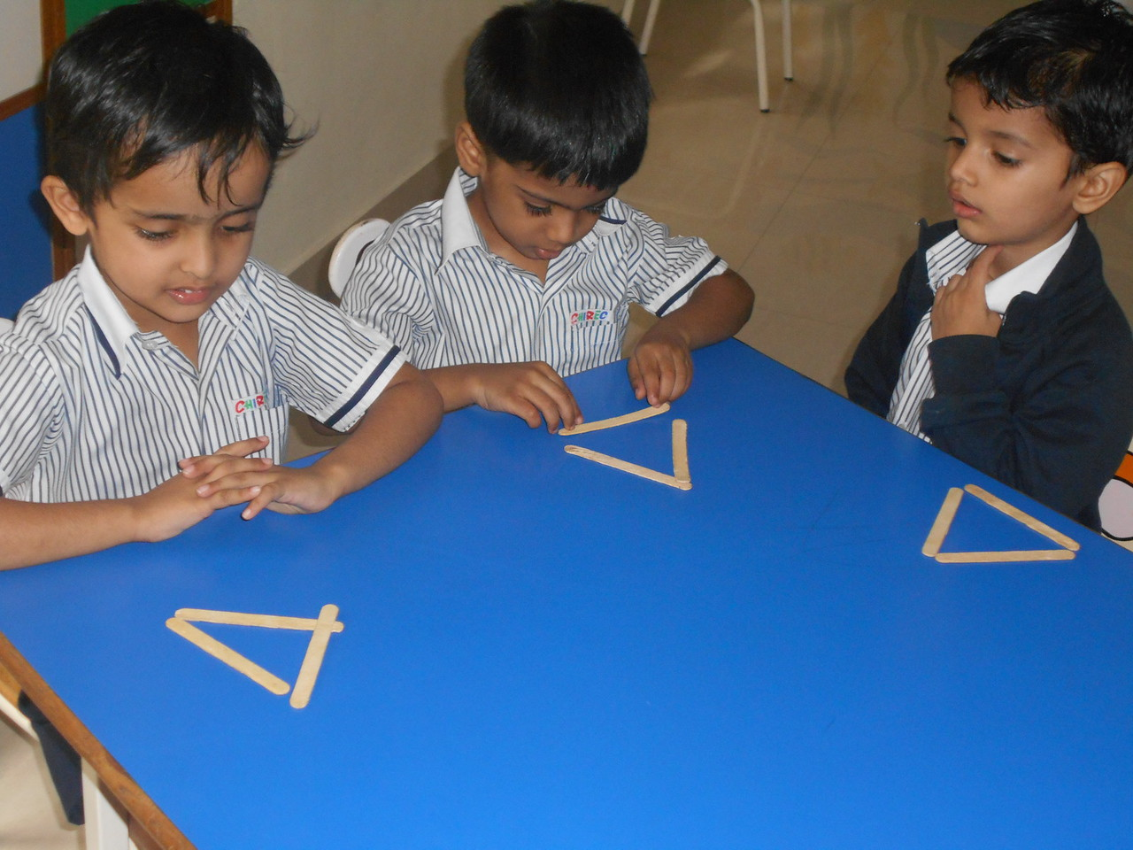 FORMING TRIANGLE WITH ICECREAM STICKS