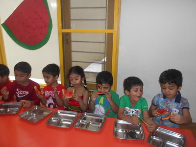 CHILDREN ENJOYING WATERMELON DURING WATERMELON PARTY 1