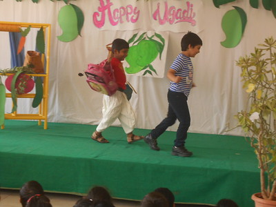CHILDREN DOING ACTION SONG DURING ASSEMBLY
