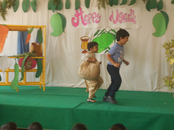 CHILDREN DOING ACTION SONG DURING ASSEMBLY PRESENTATION 2