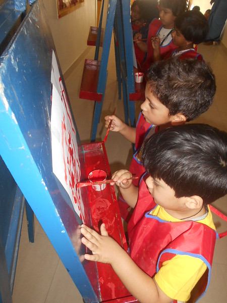 DEVELOPING FINE MOTOR SKILLS AND CREATIVE SKILLS- EASEL BOARD PAINTING (7)