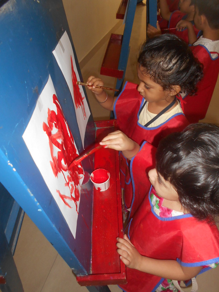 DEVELOPING FINE MOTOR SKILLS AND CREATIVE SKILLS- EASEL BOARD PAINTING (5)