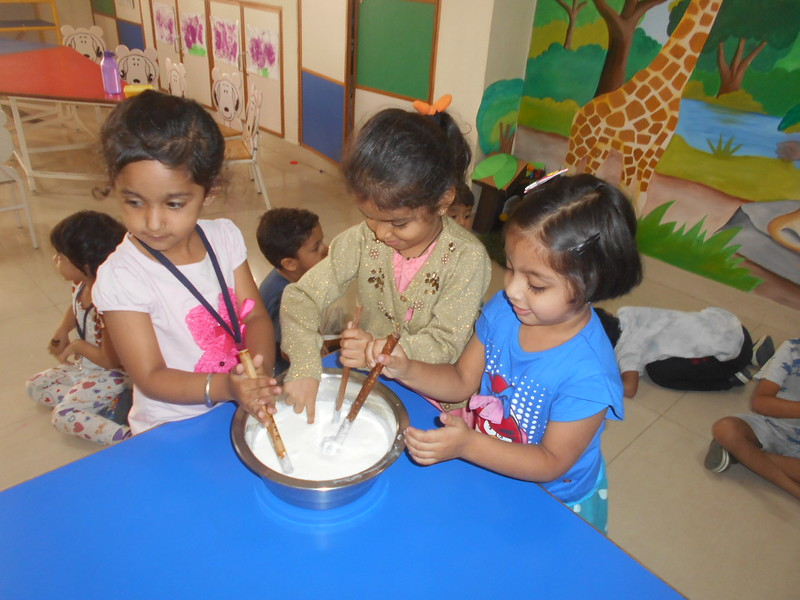 DEVELOPING FINE MOTOR SKILLS- CHURNING CURD (6)