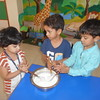 DEVELOPING FINE MOTOR SKILLS- CHURNING CURD (4)