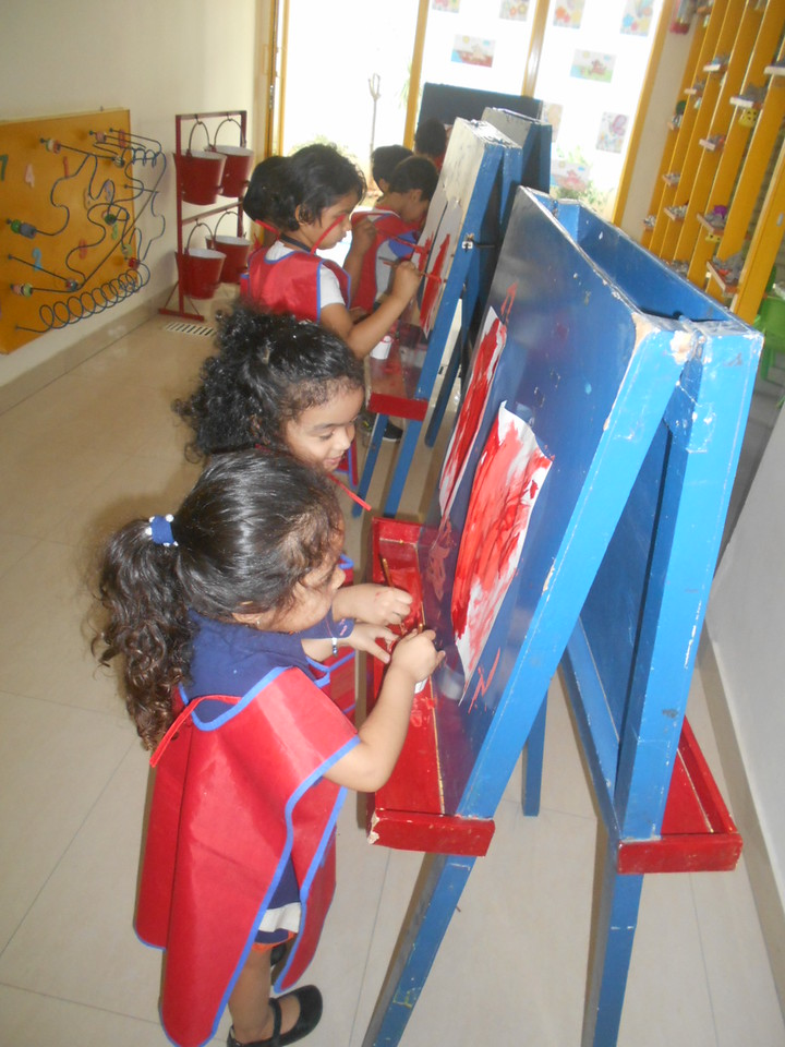 DEVELOPING FINE MOTOR SKILLS AND CREATIVE SKILLS- EASEL BOARD PAINTING (1)