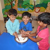 DEVELOPING FINE MOTOR SKILLS- CHURNING CURD (3)