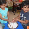 DEVELOPING FINE MOTOR SKILLS- CHURNING CURD (1)