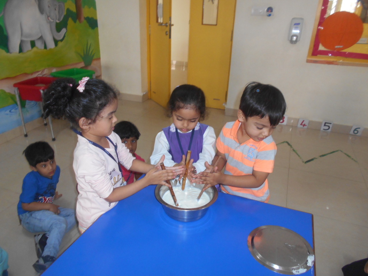 DEVELOPING FINE MOTOR SKILLS- CHURNING CURD (2)