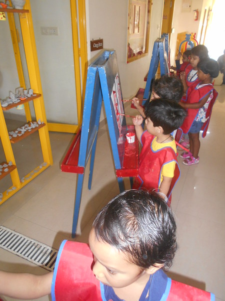 DEVELOPING FINE MOTOR SKILLS AND CREATIVE SKILLS- EASEL BOARD PAINTING (9)