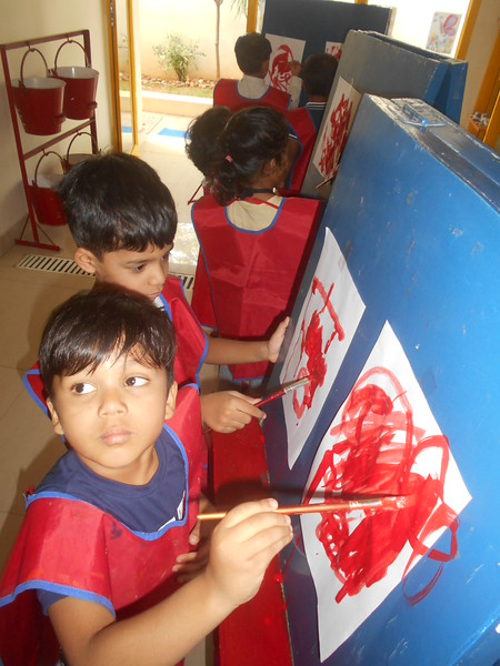 DEVELOPING FINE MOTOR SKILLS AND CREATIVE SKILLS- EASEL BOARD PAINTING (3)