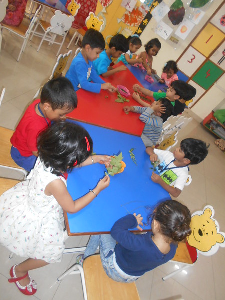 DEVELOPING FINE MOTOR AND SOCIAL SKILLS - PLUCKING CURRY LEAVES (3)