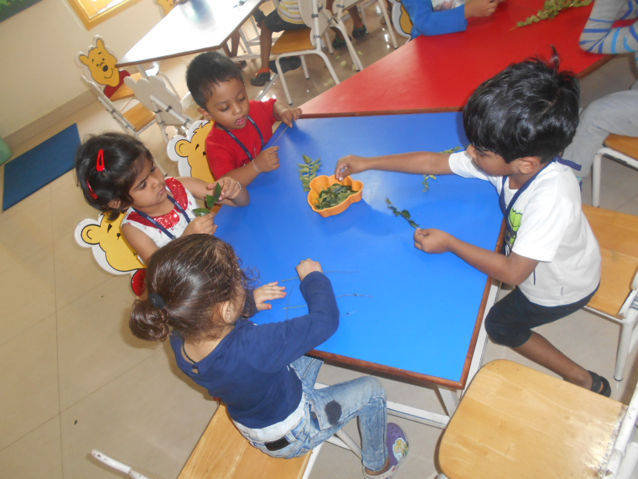 DEVELOPING FINE MOTOR AND SOCIAL SKILLS - PLUCKING CURRY LEAVES (1)