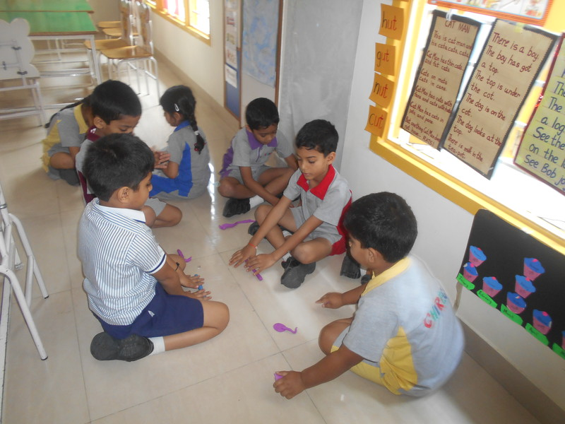 DEVELOPING CREATIVE SKILLS- ROLLING PLAY DOUGH TO MAKE THEIR  FAVOURITE WILD ANIMAL