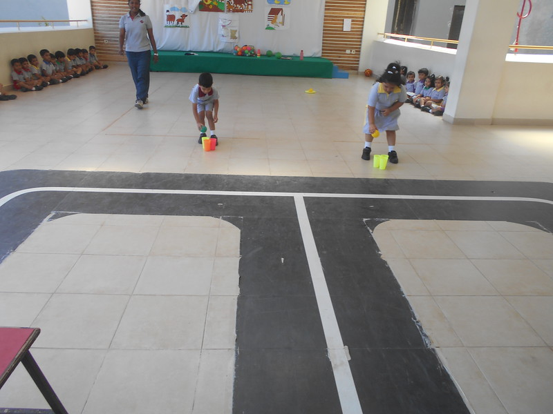 DEVELOPING GROSS MOTOR SKILLS - BALANCING BALL ON THE GLASS DURING P E T CLASS