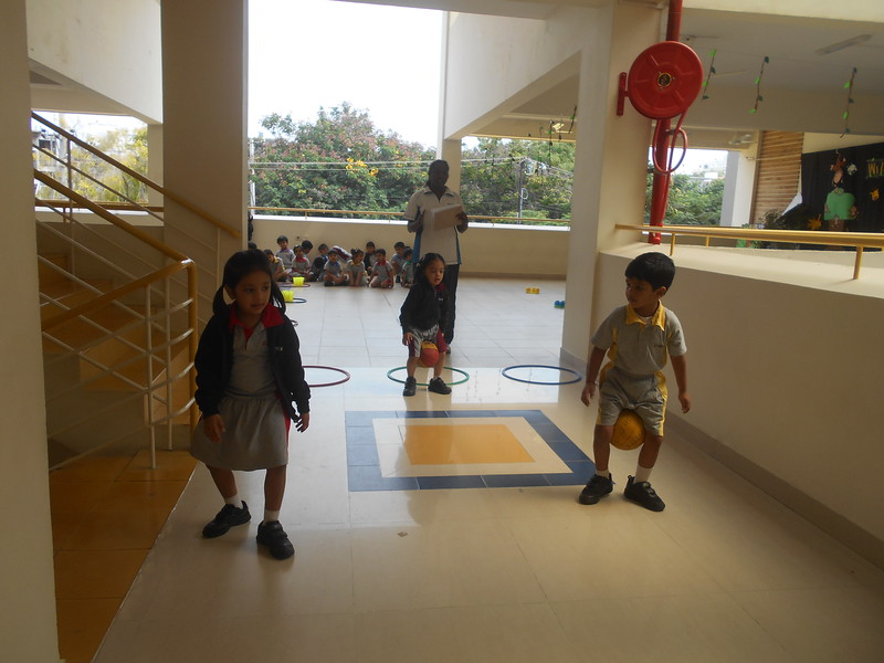 BALANCING THE BALL BETWEEN THEIR LEGS AND WALKING ACTIVITY IN P E T CLASS