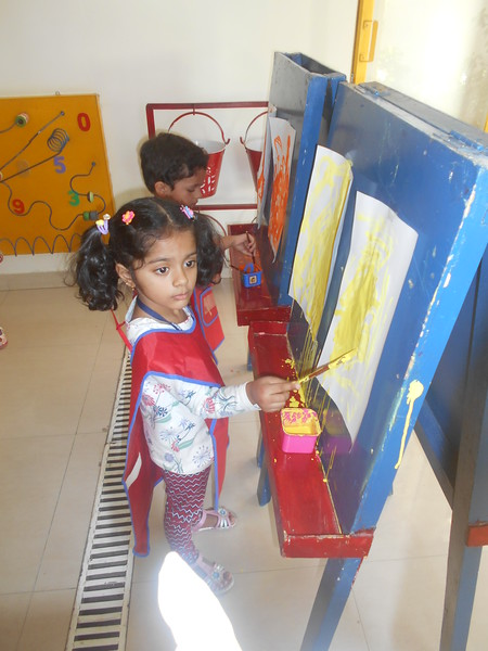 DEVELOPING FINE MOTOR AND CREATIVE SKILLS- EASEL BOARD PAINTING