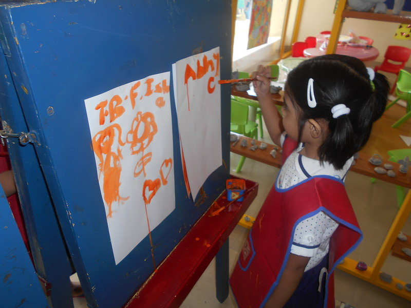 DEVELOPING CREATIVE AND FINE MOTOR SKILLS -EASEL BOARD PAINTING