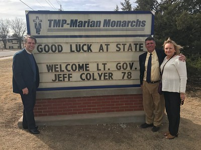 Dr. Colyer, Kansas School Board Member Jim McNeice and his wife Chris '71 (Rohleder) McNiece make a stop at the TMP-Marian Hall Street Marquis, a gift of the TMP and Marian Classes of 1966. Both Jim and Chris are former faculty as well and were married in the TMP-Marian Chapel.