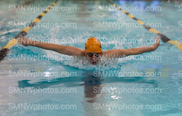 """At the JV District meet, junior Benjiman Alpert swims the 100 yard butterfly on Jan 6 at SM West. Alpert finishd with a time of 1:24.7 just 12 seconds off his fastest time. """"Missing your best time takes the wind out of you,"""" Alpert said. """"But you realize you just need to practice harder next time."""""""