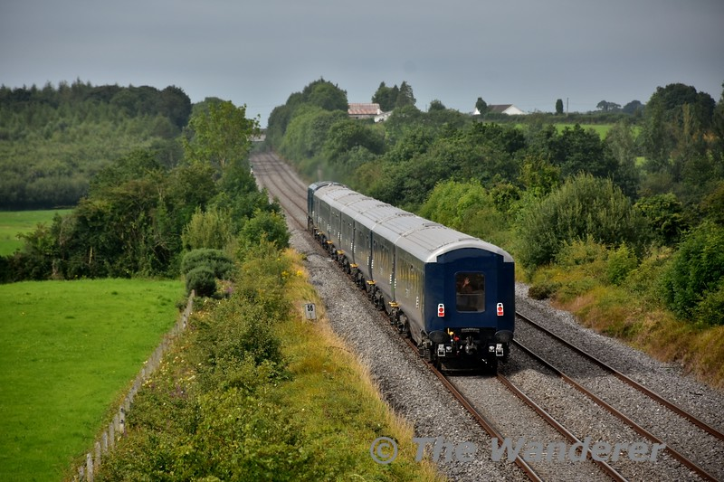 A wave from a member of staff on board 7104 Kildare as it passes Rosskelton with the 0830 Inchicore - Mallow Trial. Thurs 11.08.16