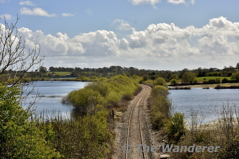 "The water levels on Ballycar Lough continue to recede and it inow appears the track is passable. Train servcies have been suspended on the Limerick - Ennis route since late December 2015. It is expected the line will reopen by the middle of May once track inspections are complete. This view looks south towards Limerick. Mon 02.05.16 <br><br><a href=""https://thewandererphotos.smugmug.com/2016Photos/January-2016/i-Q9kHjcz"" target=""_blank"">Click here</a> how a series of images of how it looked back in January 2016."