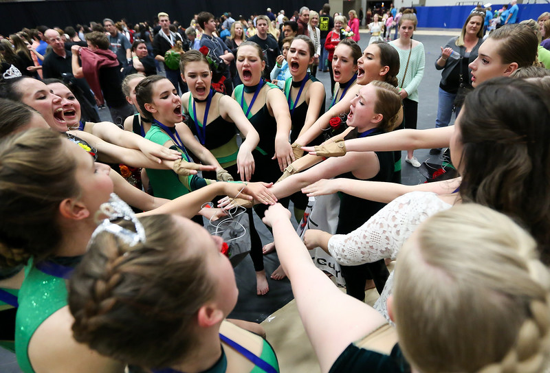 Winter Guard Cheers After 1st Place Win, Making School History