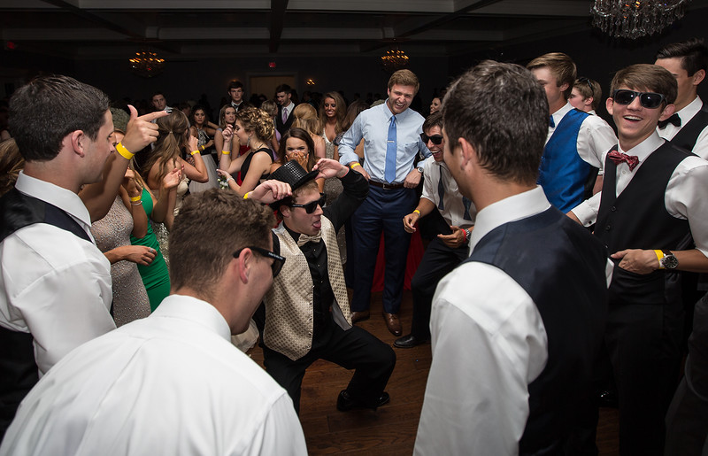 Gage McCook dances in circle of his friends during his final prom